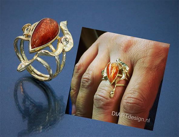 Ring met natuurlijke vormen. Goud met zonnesteen.