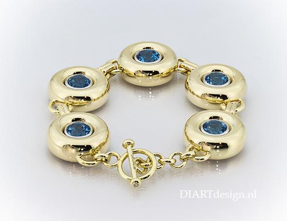 Gouden armband met topazen.